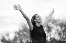 woman with arms raised to the air