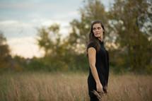 Woman in dry wheat field