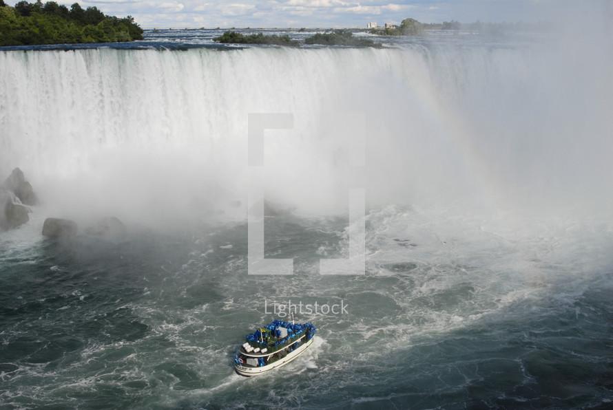 Boat approaching the foot of Niagara Falls waterfall