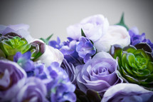 blue and purple hydrangeas and roses