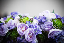 blue and purple roses and hydrangeas