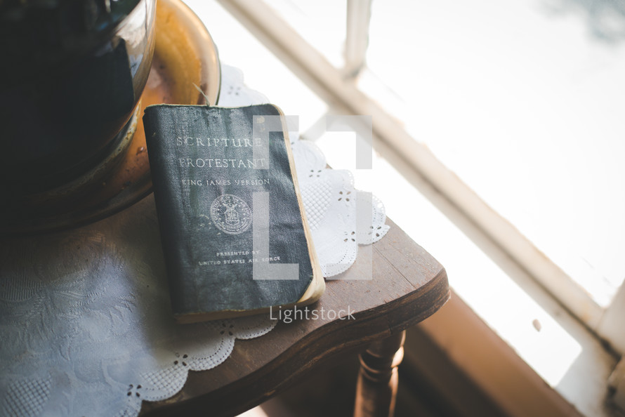 A Bible on an end table