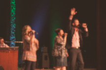 people singing worship music during a worship service