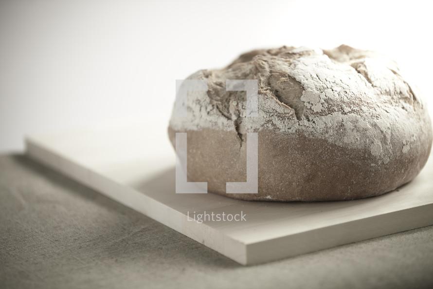 A loaf of bread sitting on a cutting board