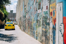 taxi cabs and graffiti covered wall
