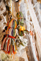 hanging tassels of yarn