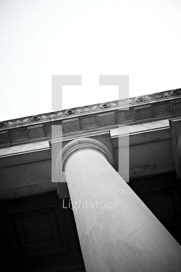 A column helps hold up the roof of a building.
