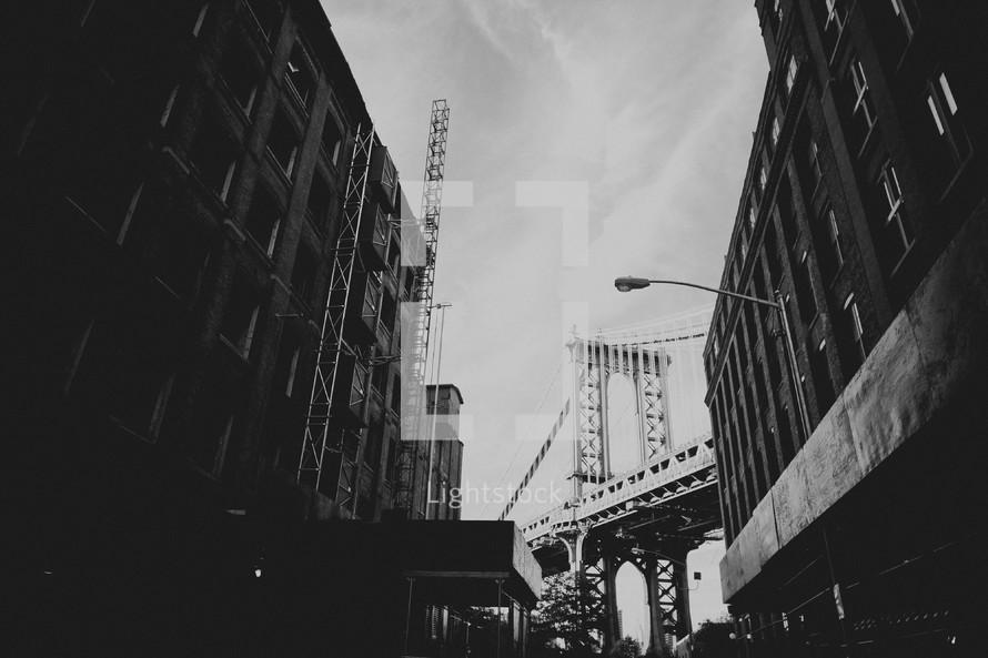 view of a bridge through a city alley