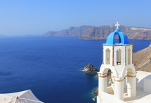 coastline and church in Greece. Bell tower overlooking Mediterranean Ocean