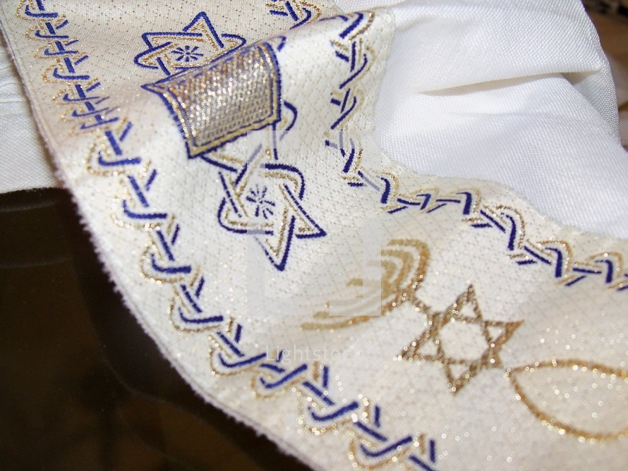 The Tallit, A Jewish Prayer Shawl that covers the head of Jewish people as they pray.