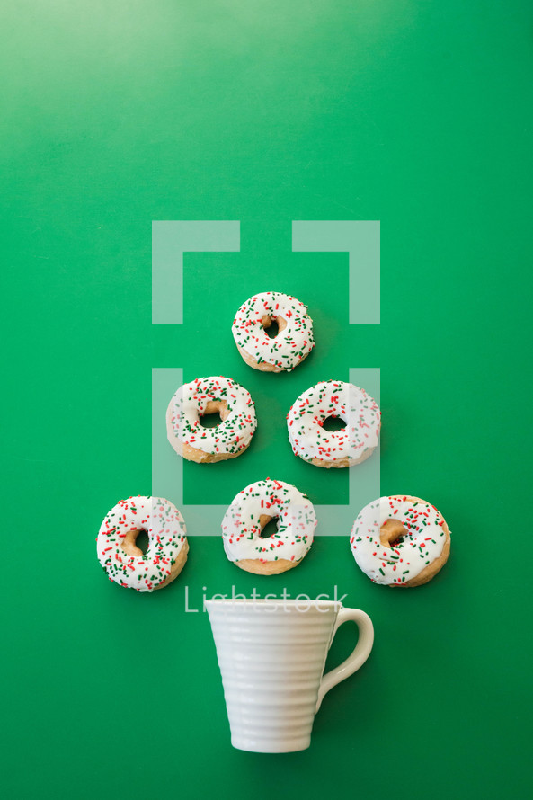 coffee mug and Christmas donuts in the shape of a Christmas tree