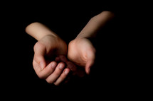 Child's hands cupped.