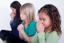 Girls praying.