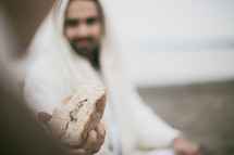 Jesus blessing the bread before communion