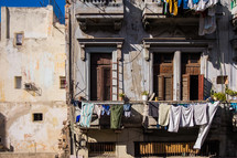 clothes hanging on a clothesline off a balcony in Havana, Cuba
