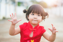 Little asian girl pray and wishing you a happy Chinese New Year