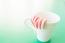 candy canes in a mug
