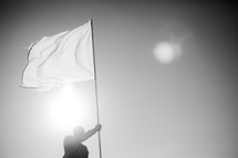 man holding a white flag - surrendering