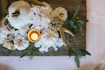 fall floral centerpiece with pumpkins