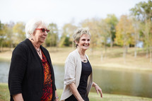 senior women walking by a pond