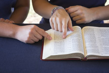 A Friend Helping Someone Study the Bible