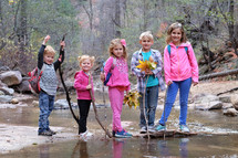 kids standing together outdoors in a stream