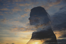 silhouette of a woman and sky at sunrise