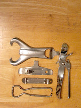 A collection of openers for cans, bottles, and jars.