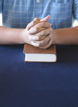 Young Person Studing the Bible and Praying