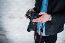 a man holding a camera