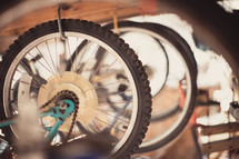 Suspended bicycle wheels.