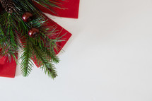 Christmas greenery with a red ribbon on a white background