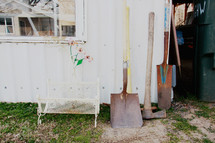 tools outdoors by a shed door