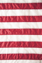 Red and white stripes of an American flag.