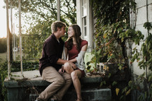 young couple sitting on a porch