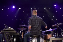 a man playing drums on stage
