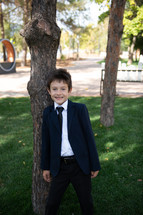 portrait of a boy in dress clothes