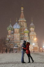 Couple kissing in front of St, Basils Cathedral, Moscow, Russia