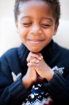 boy child with praying hands