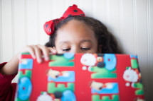 a child opening a Christmas present