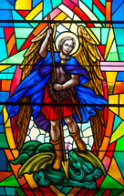 stained glass window depicting the saint Archangel Michael slaying a dragon with his sword