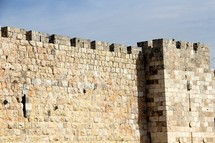 Jerusalem city wall. Stone wall with a castle edge.