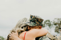 Military wife hugging her husband returning from battle