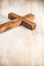 wooden cross on white wood