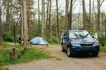 SUV and tent at a campgrounds