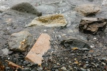 water lapping over rocks