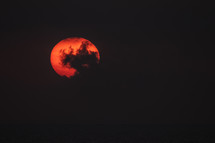 clouds over a red sun