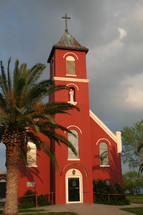 red church and palm tree