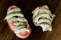avocado and tomato on a sandwich