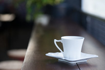 white tea cup and saucer